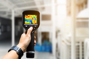 stock-photo-detecting-heat-loss-at-the-house-with-infrared-thermal-camera-108938912