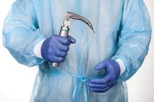 stock-photo-intern-holding-laryngoscope-isolated-on-white-background-683111209