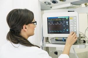 stock-photo-medical-doctor-making-ecg-test-in-hospital-medical-concept-344140508